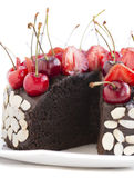 Chocolate cake with cherries. . Royalty Free Stock Photo