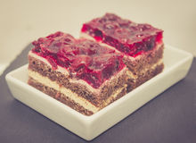 Chocolate cake with cherry jelly Royalty Free Stock Images