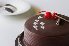 Chocolate cake and cherry for love Stock Photos