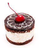 Chocolate cake with cherry on the top icing isolated Royalty Free Stock Photo