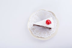 Chocolate cake. With cherry on top - white background royalty free stock photo