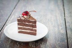 Chocolate cake with cherry topping and ice coffee mocha in outdoor cafe. Picture of chocolate cake with cherry topping and ice coffee mocha in outdoor cafe royalty free stock images