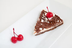 Chocolate cake with cherry Stock Photos
