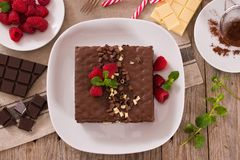 Chocolate cake. Chocolate cake with raspberries on white dish royalty free stock photo