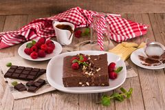 Chocolate cake. Chocolate cake with raspberries on white dish royalty free stock images