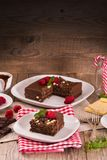 Chocolate cake. Chocolate cake with raspberries on white dish stock photos