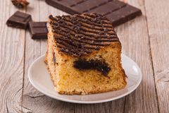 Chocolate cake. Chocolate cake with spices on wooden table stock image