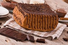 Chocolate cake. Chocolate cake with spices on wooden table stock photo