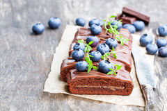 Chocolate  cake with  chocolate cream and fresh blueberries. Chocolate  cake with chocolate cream and fresh blueberries Stock Images