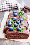 Chocolate  cake with  chocolate cream and fresh blueberries. Chocolate  cake with chocolate cream and fresh blueberries Stock Photo