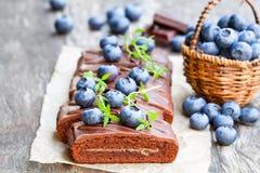 Chocolate  cake with  chocolate cream and fresh blueberries. Chocolate  cake with chocolate cream and fresh blueberries Stock Photos