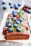 Chocolate  cake with  chocolate cream and fresh blueberries. Chocolate  cake with chocolate cream and fresh blueberries Royalty Free Stock Photos