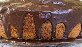Chocolate cake with chocolate dripping from the top Stock Image