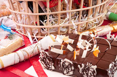 Chocolate cake close up. Christmas chocolate cake with a hamper basket at the background Stock Photography
