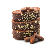 Chocolate cake and cocoa beans Royalty Free Stock Photo