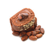 Chocolate cake and cocoa beans Royalty Free Stock Image