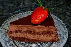 Chocolate cake with cocoa cream and strawberries royalty free stock photo