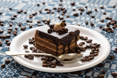 Chocolate cake and coffee beans Royalty Free Stock Photos