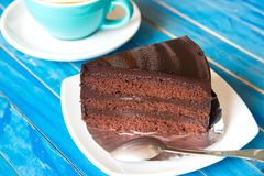 Chocolate cake and fresh coffee on blue wooden table. Royalty Free Stock Photo