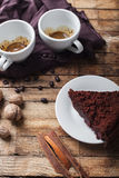 Chocolate cake, coffee and cinnamon sticks Stock Images