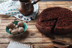 Chocolate cake, coffee and cinnamon sticks Stock Photos