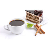 Chocolate cake, coffee and green leafage Stock Images