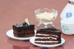 Chocolate cake, coffee served on table Stock Images