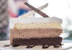 Chocolate cake with coffee on the table Stock Images