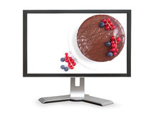 Chocolate cake on computer monitor Royalty Free Stock Photo