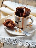 Chocolate cake cooked in a cup in the microwave for 2 minutes. Rustic style. Selective focus. Royalty Free Stock Photography