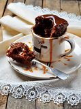 Chocolate cake cooked in a cup in the microwave for 2 minutes. Rustic style. Selective focus. Stock Photography