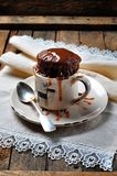 Chocolate cake cooked in a cup in the microwave for 2 minutes. Rustic style. Selective focus. Stock Photo