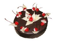 Chocolate cake covered with chocolate and decorated with cherries stock photos