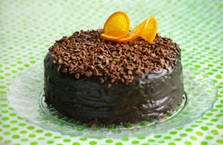 Chocolate cake covered with ganache and orange peel Stock Photography