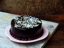 Chocolate cake covered a mirror coating. Homemade chocolate cake covered a mirror coating royalty free stock photo