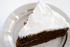 Chocolate cake with cream. Chocolate cake with white cream on a white plate Royalty Free Stock Photo