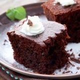 Chocolate cake with cream Royalty Free Stock Image