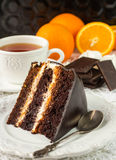 Chocolate cake with cream and fruit Royalty Free Stock Images
