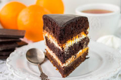 Chocolate cake with cream and fruit Royalty Free Stock Photos
