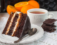 Chocolate cake with cream and fruit Royalty Free Stock Image