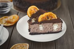 Chocolate cake with cream and profiterole Royalty Free Stock Photography