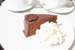 Chocolate cake with cream Royalty Free Stock Images
