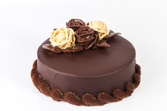 Chocolate cake with creamy roses decoration on top Stock Image