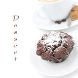 Chocolate cake and a cup of cappuccino, close-up,  Royalty Free Stock Photo