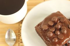 Chocolate cake a cup of coffee Stock Image