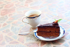 A chocolate cake with a cup of coffee.  Royalty Free Stock Image