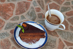 A chocolate cake with a cup of coffee. Royalty Free Stock Photos