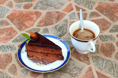 A chocolate cake with a cup of coffee. Stock Photo