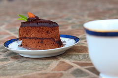 A chocolate cake with a cup of coffee. A chocolate cake with a cup of coffee Royalty Free Stock Photography