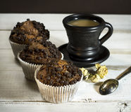 Chocolate cake, a cup of coffee with milk. Stock Image